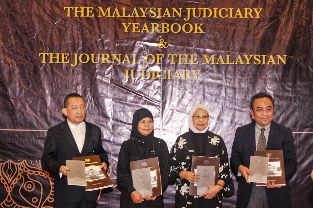 (From left) Tan Sri Idrus Harun, Malaysia Chief Justice Tan Sri Tengku Mainun Tuan Man, Datuk Rohana Yusuf and Tan Sri Azhar Mohamed at the launch of the Judicial Year Book 2018 in Putrajaya November 27, 2019. — Picture by Shafwan Zaidon