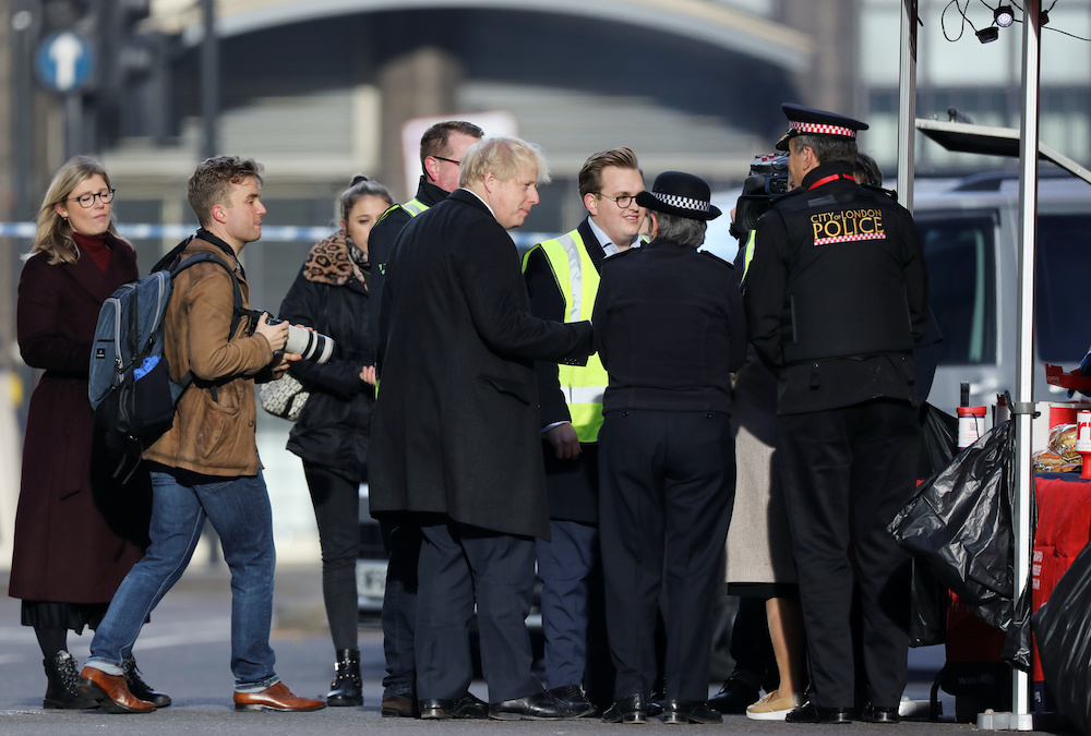 Britain's Prime Minister Boris Johnson arrives at the scene of a stabbing on London Bridge, in which two people were killed, in London, Britain, November 30, 2019. — Reuters pic
