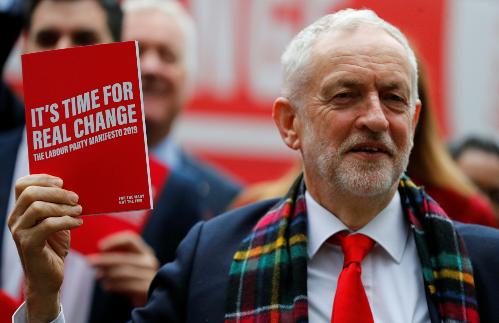 Leader of the Labour Party Jeremy Corbyn holds his party's general election manifesto at its launch in Birmingham, Britain November 21, 2019. — Reuters pic