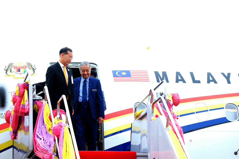 Prime Minister Tun Dr Mahathir Mohamad and his wife Tun Dr Siti Hasmah Mohd Ali (not seen) arrive at Military Air Terminal Two, Wing Six of Don Mueang International Airport in Bangkok November 1, 2019. — Bernama pic