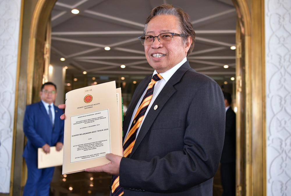 Chief Minister Datuk Patinggi Abang Johari Openg holds a copy of the Sarawak Budget 2020 in Kuching November 4, 2019. — Bernama pic