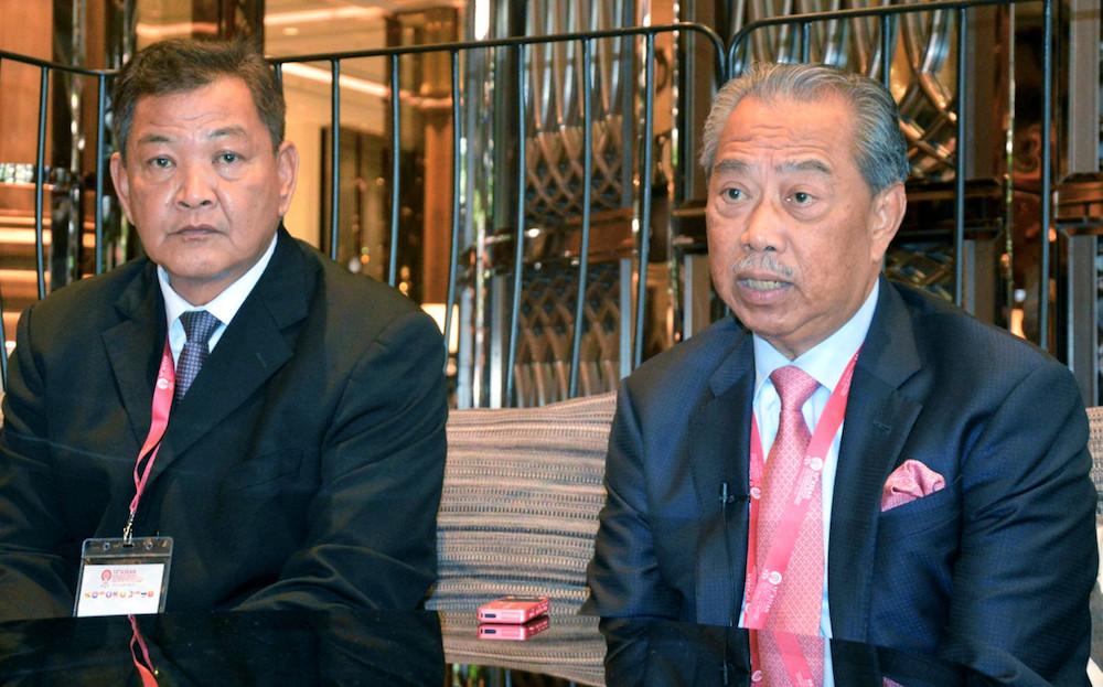 IGP Tan Sri Abdul Hamid Bador and Home Minister Tan Sri Muhyiddin Yassin speak to reporters in Bangkok November 28, 2019. — Bernama pic