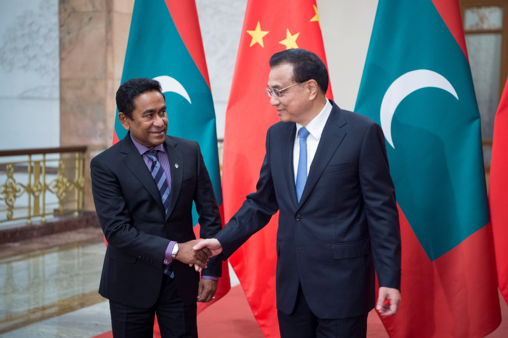 File picture of Chinese Premier Li Keqiang shaking hands with Maldives President Abdulla Yameen at the Great Hall of the People in Beijing, China December 7, 2017. — Reuters pic