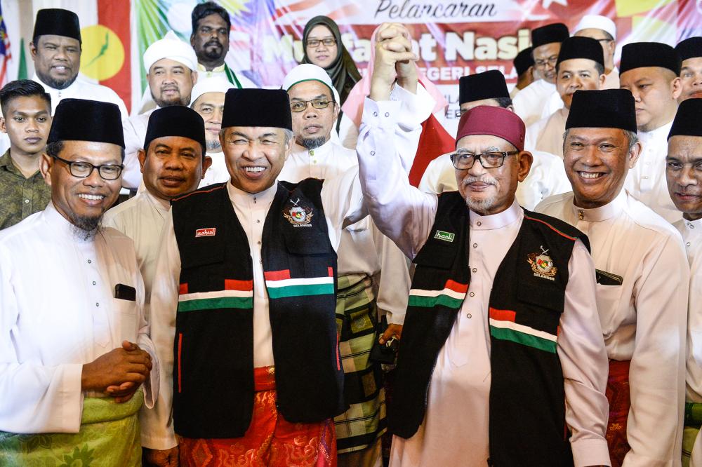 Umno President Datuk Seri Ahmad Zahid Hamidi and PAS President Datuk Seri Hadi Awang during the launch of Muafakat Nasional Selangor in Shah Alam November 23, 2019. — Picture by Miera Zulyana