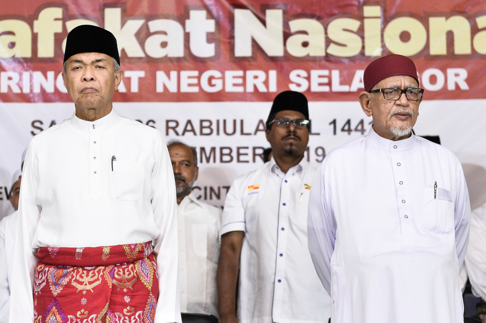 Umno President of Datuk Seri Ahmad Zahid Hamidi and PAS President Datuk Seri Abdul Hadi Awang during the launching of Muafakat Nasional Selangor in Shah Alam November 23, 2019. — Picture by Miera Zulyana