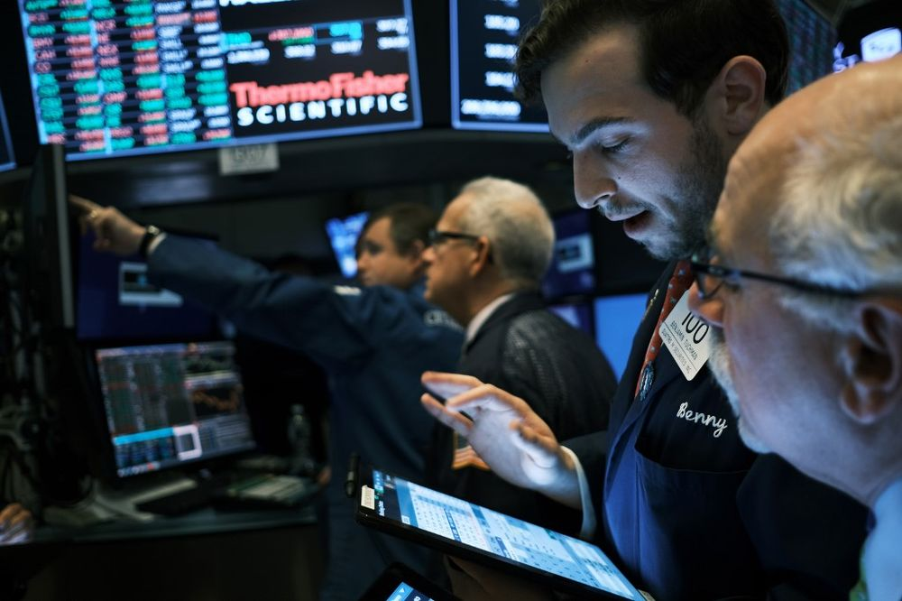Traders work on the floor of the New York Stock Exchange (NYSE) on November 20, 2019 in New York City. — AFP pic