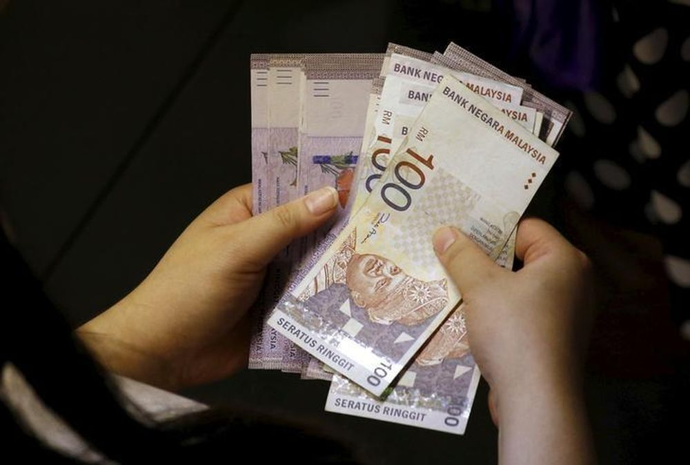 The ringgit is expected to remain stable and trade in a range of between 3.97 and 4.30 against US dollar in 2020. — Reuters pic