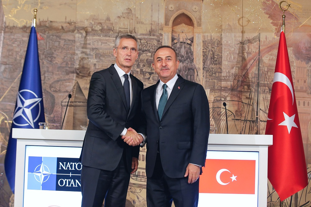 Turkish Foreign Minister Mevlut Cavusoglu shakes hands with Nato Secretary-General Jens Stoltenberg after a news conference in Istanbul, Turkey October 11, 2019. ― Reuters pic
