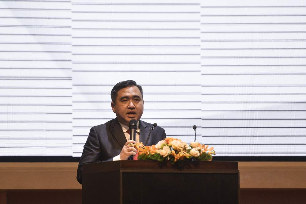 Transport Minister Anthony Loke says there is already a positive change in the attitude of Malaysian commuters towards public transportation, as there are 100,000 people who have subscribed to the government-subsidised monthly travel pass. ― Picture by Miera Zulyana