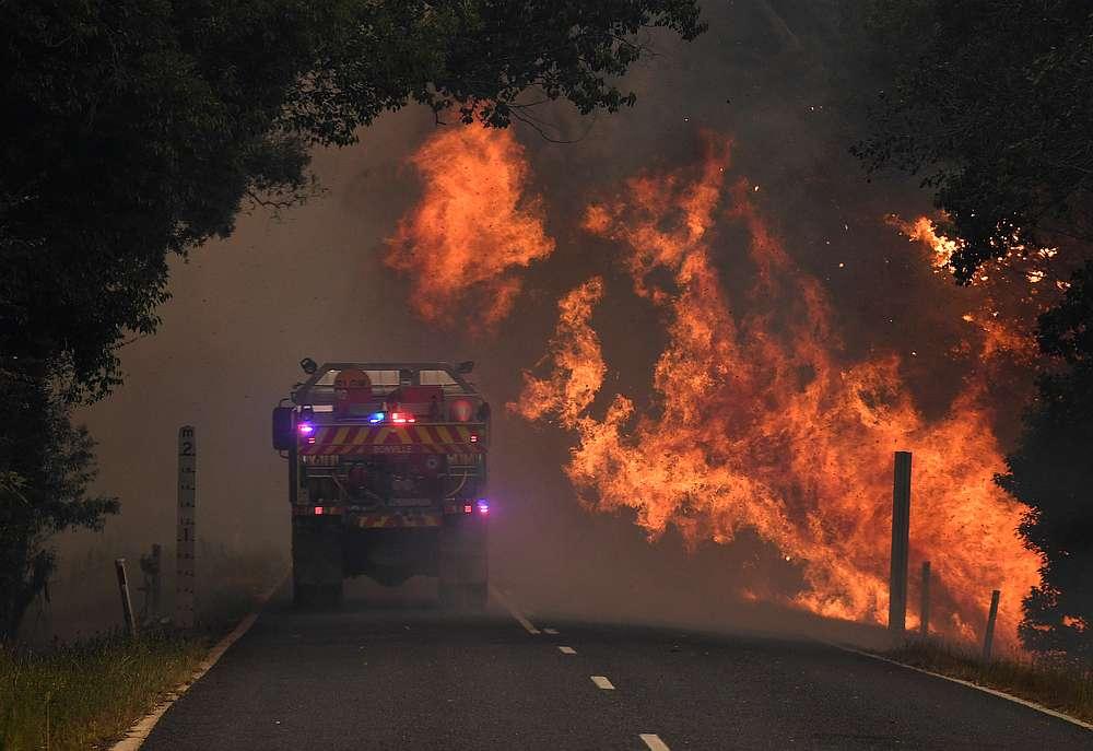 A fire truck is seen near a bushfire in Nana Glen, near Coffs Harbour, Australia November 12, 2019. — AAP Image/Dan Peled via Reuters
