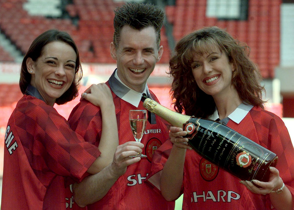 TV Chef Gary Rhodes (centre) launches Manchester United's own label champagne with models Emma Hartley (left) and Gaynor Smith at Old Trafford, Britain July 9, 1997. ― Reuters pic