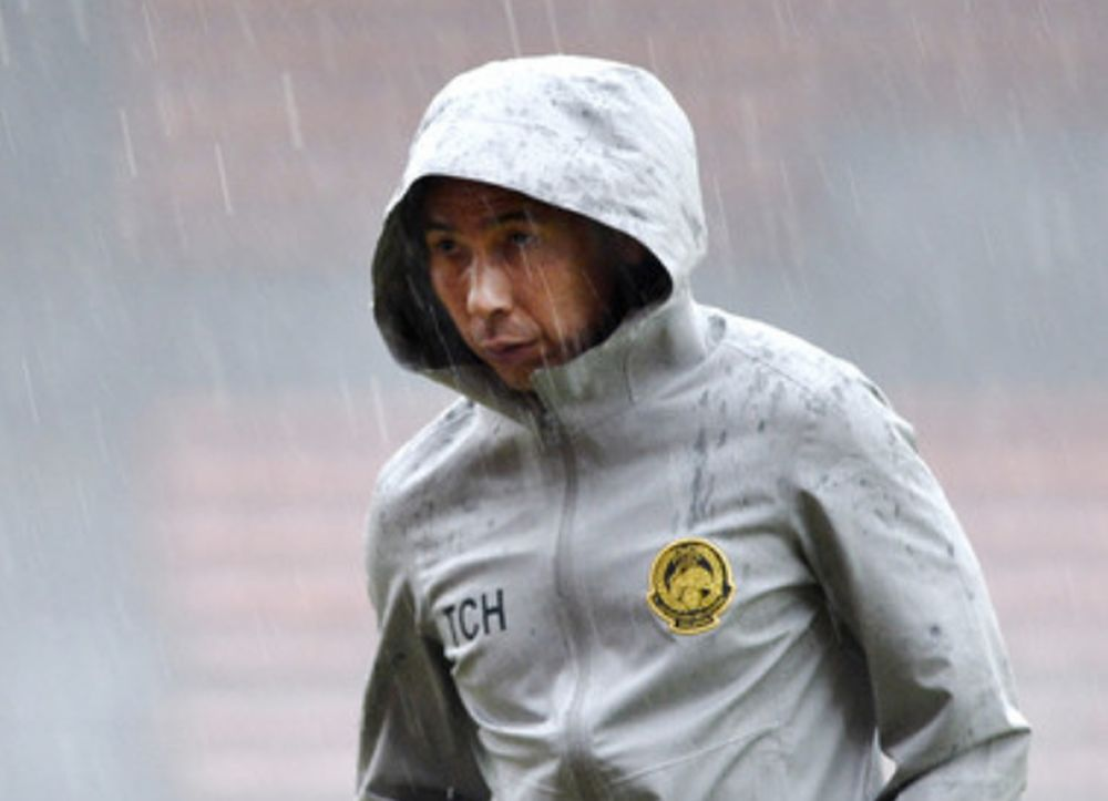 National coach Tan Cheng Hoe walks out of the field after a suspended training session following heavy rain as he prepares for Malaysia against Indonesia in the 2022 World Cup/Asia Cup 2023 qualifying at the Cheras Stadium Nov 16, 2019. — Bernama pic