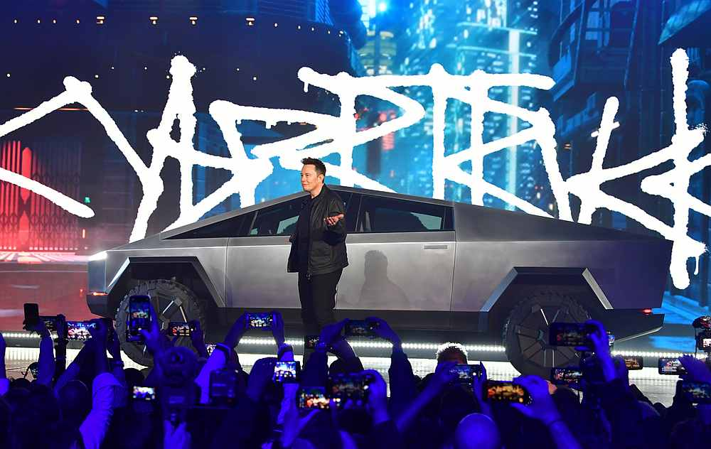 Tesla co-founder and CEO Elon Musk unveils the all-electric battery-powered Tesla's Cybertruck. — AFP pic