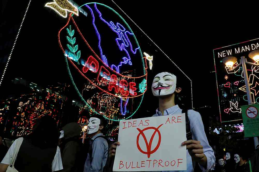 Anti-government protesters take part in a Guy Fawkes-themed march in Hong Kong November 5, 2019. — Reuters pic