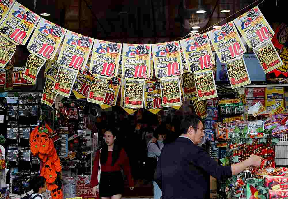 A man chooses goods underneath banners notifying the rise in the national sales tax at a store in Tokyo, Japan September 25, 2019. — Reuters pic
