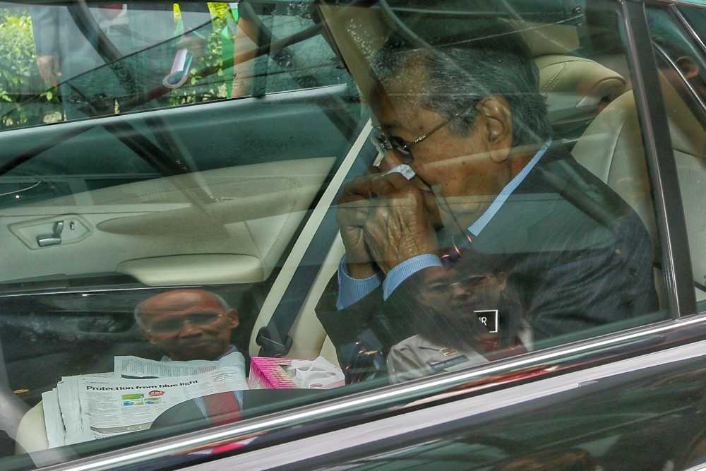 Prime Minister Tun Dr Mahathir Mohamad was seen wiping his nose with a white handkerchief. ― Picture by Ahmad Zamzahuri