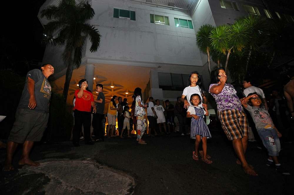 Visitors gather outside a hotel building following the earthquake that hit in Manado, North Sumatra province, Indonesia, November 14, 2019. — Antara Foto/Aloysius Jarot Nugroho via Reuters