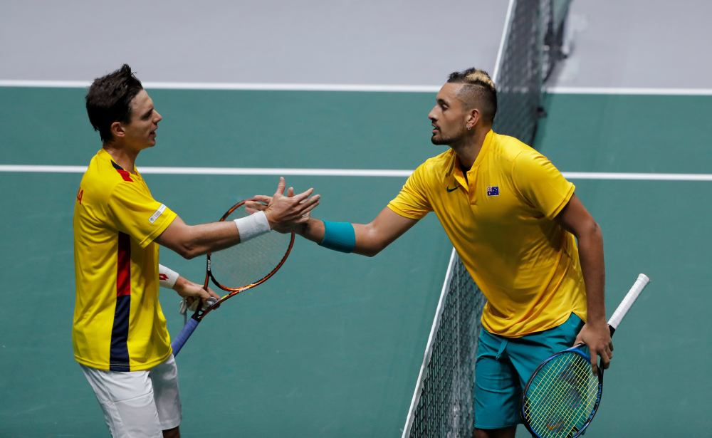 Australia's Nick Kyrgios shakes hands with Colombia's Alejandro Gonzalez after their group stage match in Madrid November 19, 2019. ― Reuters pic