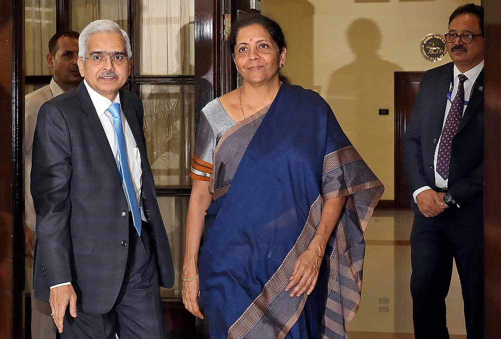 India's Finance Minister Nirmala Sitharaman (centre) and the Reserve Bank of India Governor Shaktikanta Das (left) arrive for a RBI's central board meeting in New Delhi July 8, 2019. — Reuters pic