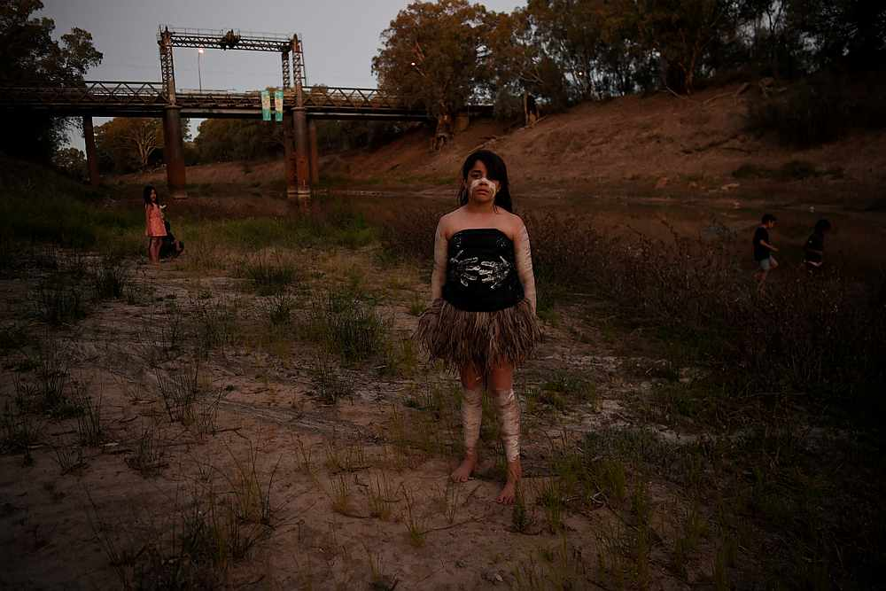 Ngiyaampaa girl Punta Williams poses on the dry riverbed before performing at Yaama Ngunna Baaka Corroboree Festival on the banks of the Darling River in Wilcannia, New South Wales, Australia October 1, 2019. — Reuters pic
