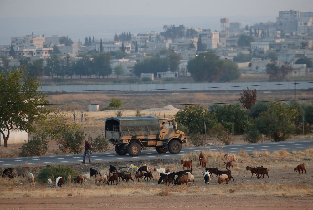 A Turkish military truck drives on the Turkish-Syrian border, with the Syrian town of Kobani in the background, in Suruc, in Sanliurfa province October 31, 2019. — Reuters pic