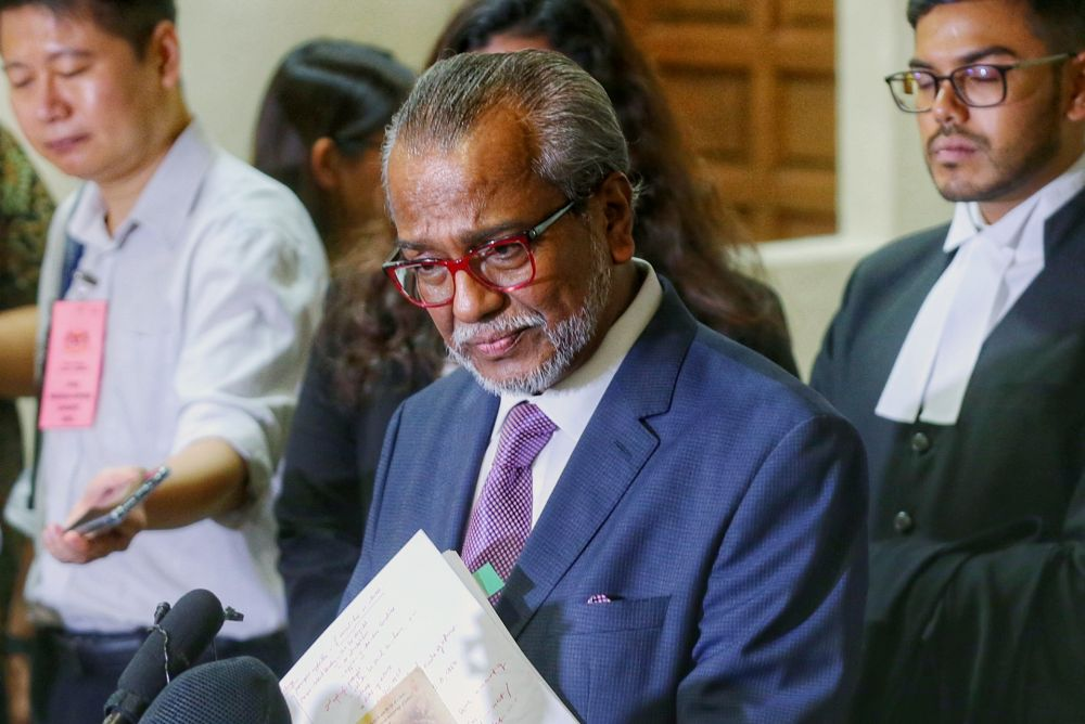 Lawyer Tan Sri Muhammad Shafee Abdullah speaks to reporters at the Kuala Lumpur High Court November 11, 2019. — Picture by Ahmad Zamzahuri