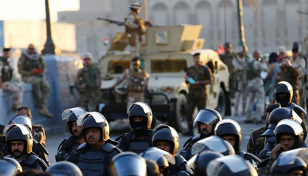 Riot police stand at Al Shuhada bridge during ongoing anti-government protests, in Baghdad Iraq November 5, 2019.  — Reuters pic