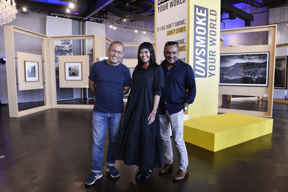(From left) Lok, Nadirah Zakariya, and SC Shekar at the 'Unsmoke: Through the Lenses of Malaysians' exhibition at Colony, Star Boulevard in Kuala Lumpur. — Picture by Miera Zulyana