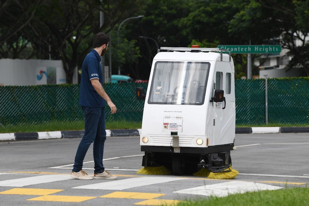 An autonomous road sweeper stops as it reacts to a pedestrian walking during a trial test at CETRAN run by the Nanyang Technological University (NTU) in Singapore December 5, 2019. — AFP pic