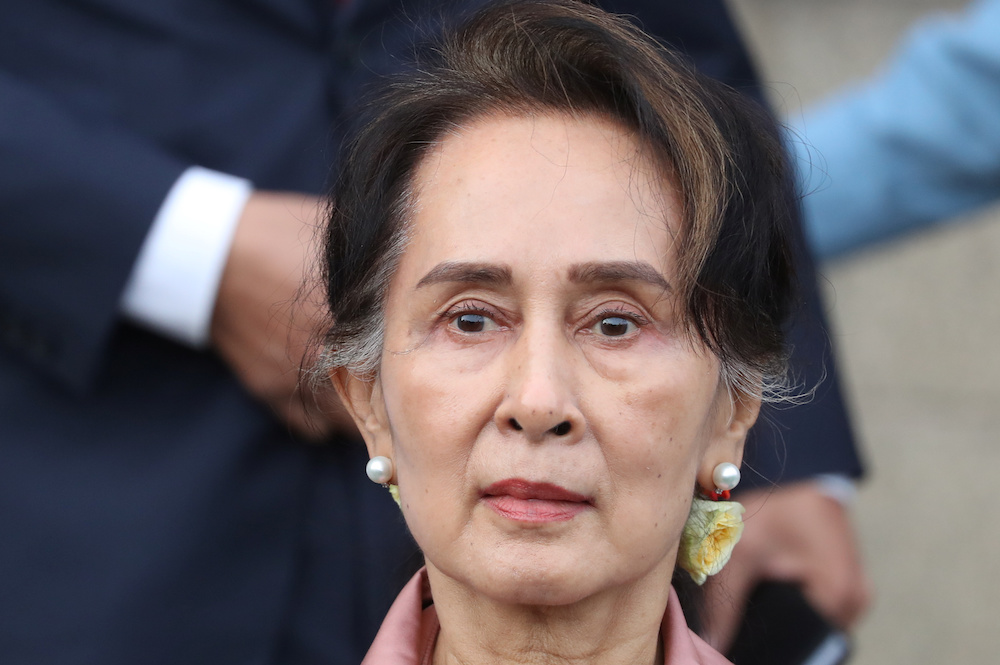 Myanmar's leader Aung San Suu Kyi leaves after attending a hearing at the International Court of Justice (ICJ) in The Hague December 10, 2019. — Reuters pic