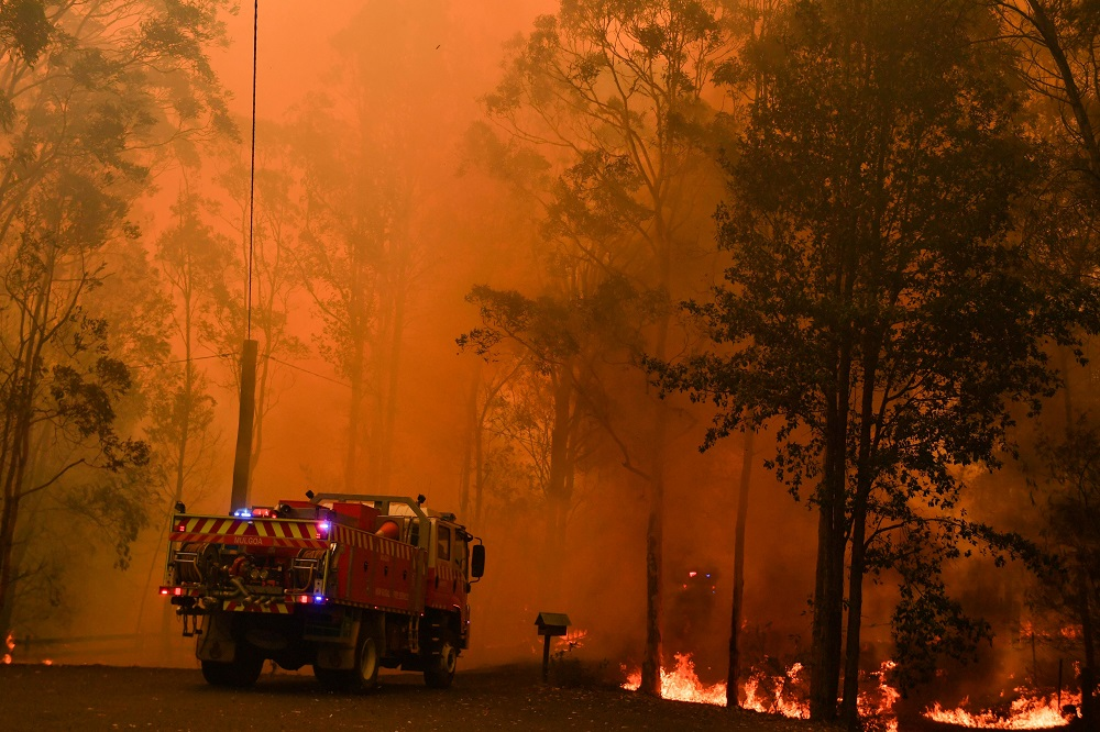 Fire trucks are seen during a bushfire in Werombi, 50 km southwest of Sydney December 6, 2019. — Picture by AAP Image/Mick Tsikas/via Reuters