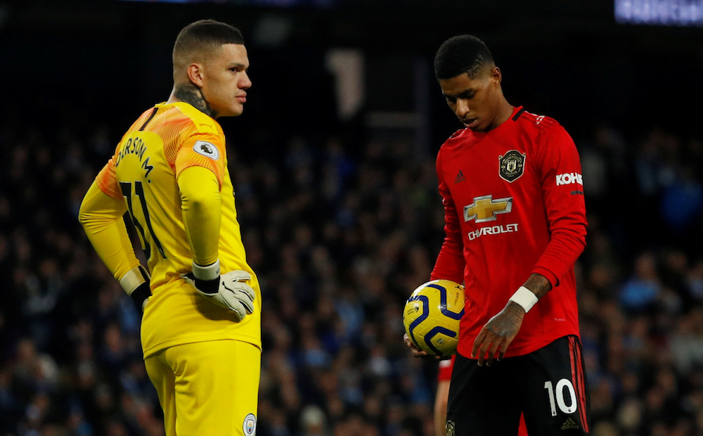 Manchester United's Marcus Rashford prepares to take a penalty as Manchester City's Ederson looks on during their Premier League match at Etihad Stadium in Manchester December 7, 2019. — Reuters pic