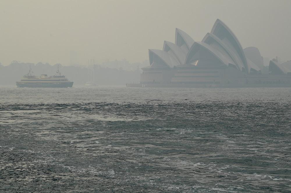 The Sydney Opera House can be seen as smoke haze from bushfires in New South Wales blankets the CBD in Sydney December 10, 2019. — AAP Image/Joel Carrett via Reuters