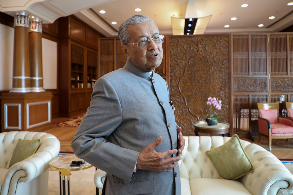 Malaysia's Prime Minister Tun Dr Mahathir Mohamad reacts during an interview with Reuters in Putrajaya December 10, 2019. — Reuters pic