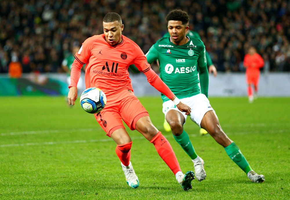 Paris St Germain's Kylian Mbappe in action with Saint Etienne's Wesley Fofana during their Ligue 1 match at Stade Geoffroy-Guichard in Saint-Etienne December 15, 2019. — Reuters pic