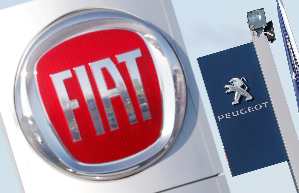 The logos of car manufacturers Fiat and Peugeot are seen in front of dealerships of the companies in Saint-Nazaire, France November 8, 2019. — Reuters pic