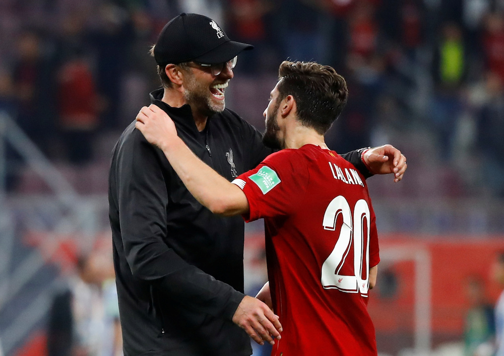 Liverpool manager Jurgen Klopp celebrates with Adam Lallana after the Club World Cup semi-final match with Monterrey at Khalifa International Stadium in Doha December 18, 2019. — Reuters pic