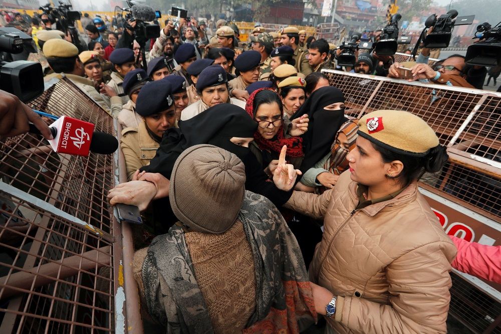 Police officers detain demonstrators during a protest against a new citizenship law at Red Fort in Delhi December 19, 2019. — Reuters pic