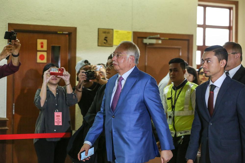 Former prime minister Datuk Seri Najib Razak walks past the media scrum at the Kuala Lumpur Courts Complex December 3, 2019. — Picture by Yusof Mat Isa