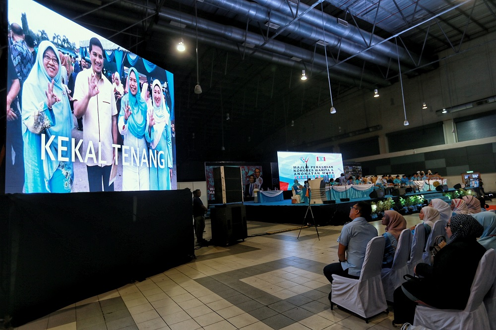 Delegates watch a video presentation during the PKR Women and Youth National Congress in Melaka December 4,2019. — Picture by Ahmad Zamzahuri