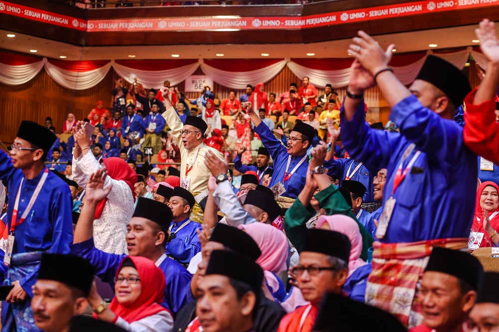Delegates attend the 2019 Umno General Assembly at Putra World Trade Centre in Kuala Lumpur December 7, 2019. — Picture by Firdaus Latif
