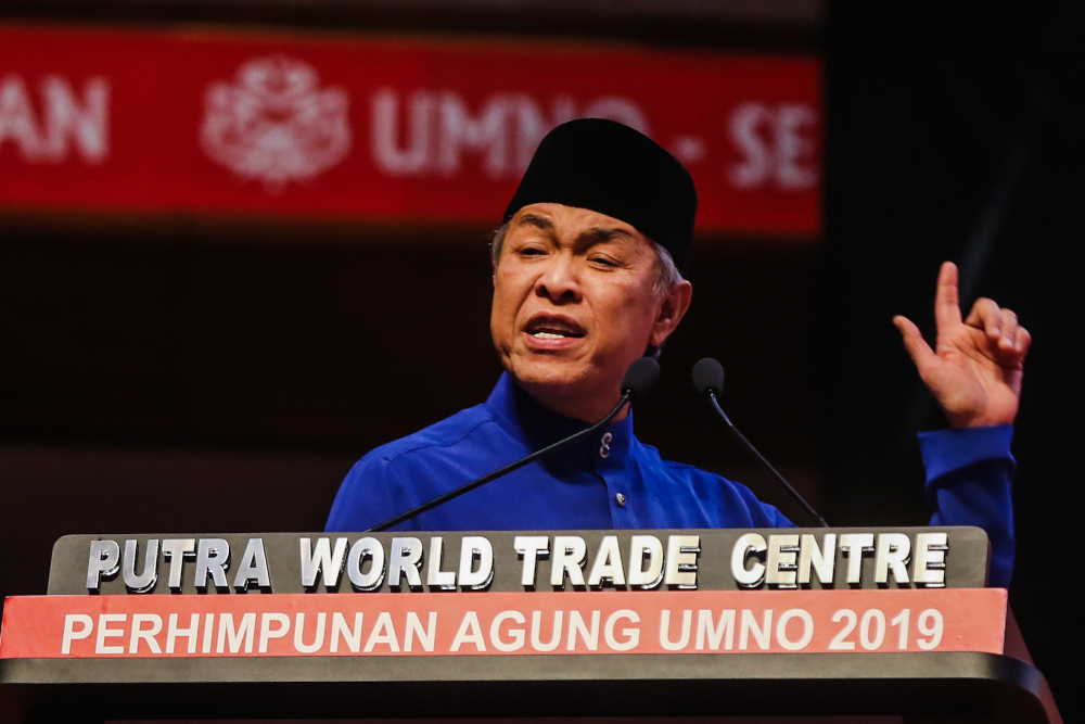 Umno president Datuk Seri Ahmad Zahid Hamidi delivers his speech during the Umno General Assembly 2019 at PWTC in Kuala Lumpur December 7, 2019 — Picture by Firdaus Latif