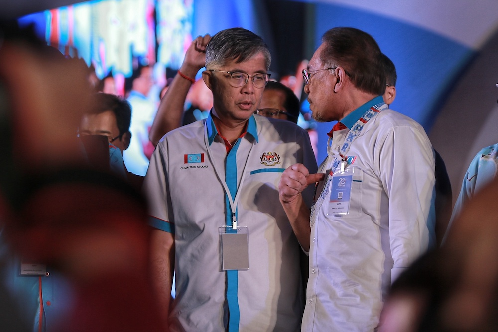 Chua Tian Chang and Datuk Seri Anwar Ibrahim interact during the 2019 PKR National Congress at MITC in Ayeh Keroh, Melaka December 8, 2019. — Picture by Ahmad Zamzahuri