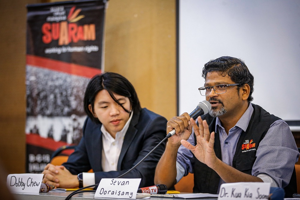 Suaram executive director Sevan Doraisamy (right) speaks during a press conference in Kuala Lumpur December 9, 2019. — Picture by Hari Anggara