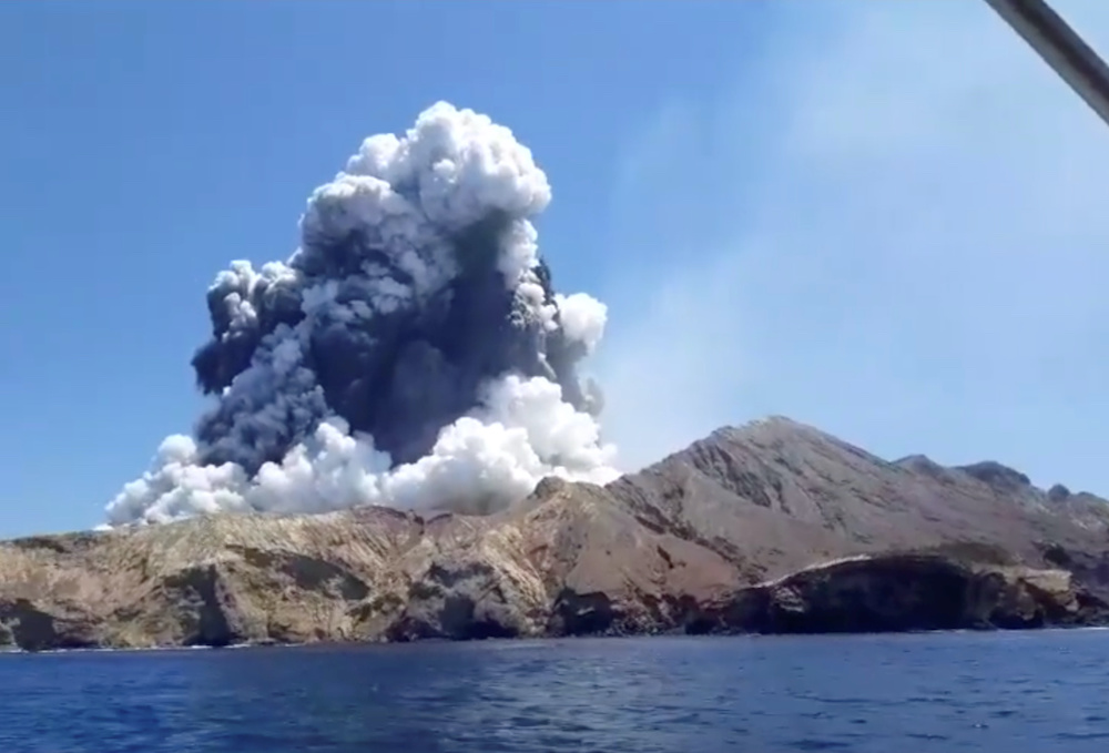 Smoke from the volcanic eruption of Whakaari, also known as White Island, is pictured from a boat, New Zealand December 9, 2019 in this picture grab obtained from a social media video. — Instagram pic via Reuters