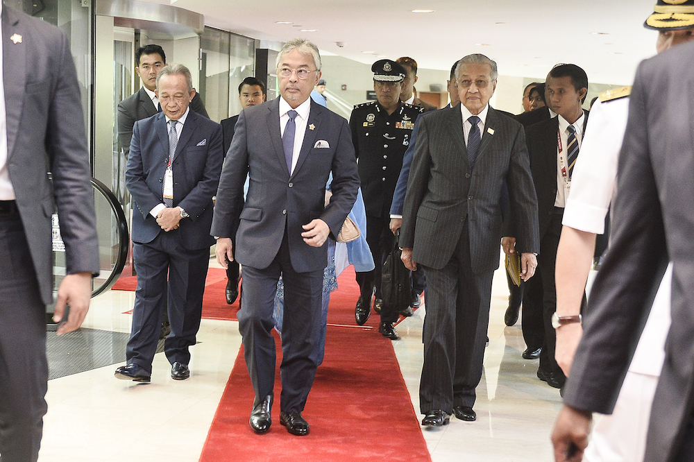 Yang di-Pertuan Agong Al-Sultan Abdullah Ri'ayatuddin Al-Mustafa Billah Shah and Prime Minister Tun Dr Mahathir Mohamad attend the Kuala Lumpur Summit 2019 December 19, 2019. — Picture by Miera Zulyana