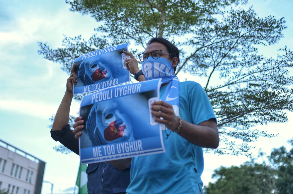 Protesters hold placards and march as they attend a 'silent protest' by Angkatan Belia Islam Malaysia (Abim) and Global Peace Mission (GPM) Malaysia at BACC in Kajang December 21, 2019. — Picture by Shafwan Zaidon
