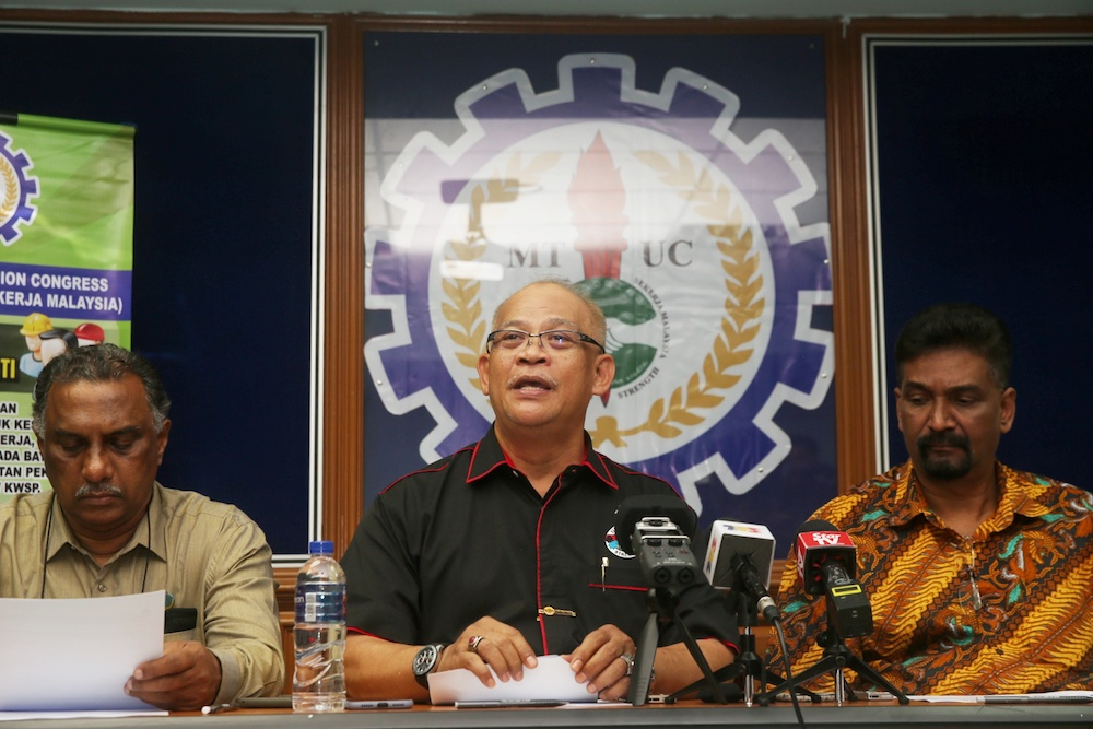 (From left) MTUC vice-president (private sector) R. Jey Kumar, president Datuk Abdul Halim Mansor and secretary-general J. Solomon attend a press conference in Subang Jaya December 26, 2019. — Picture by Choo Choy May