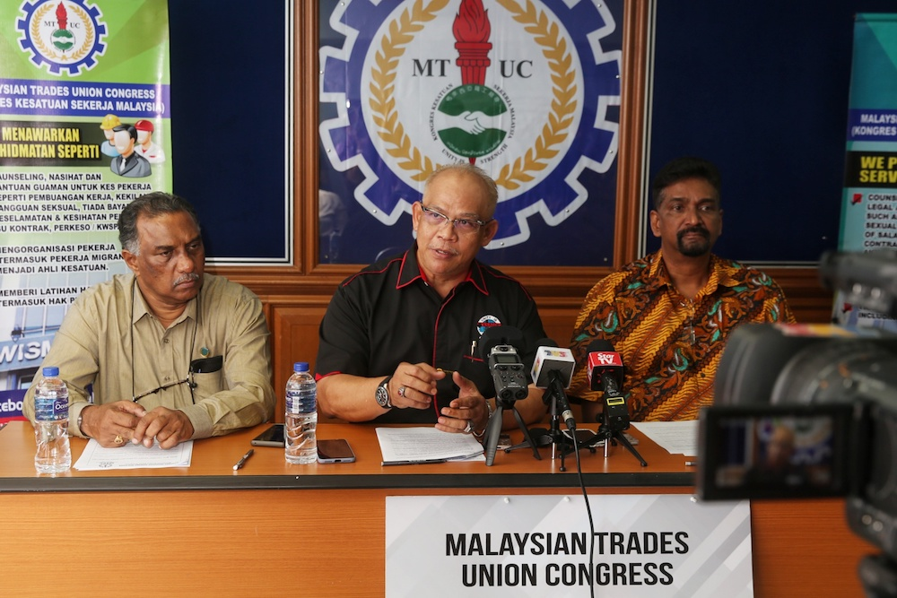 MTUC secretary-general J. Solomon (right) said that the call was not related to any position the previous Pakatan Harapan administration had taken on the free trade agreement, and the objection was because the deal poses significant threat to workers right in the country. — Picture by Choo Choy May