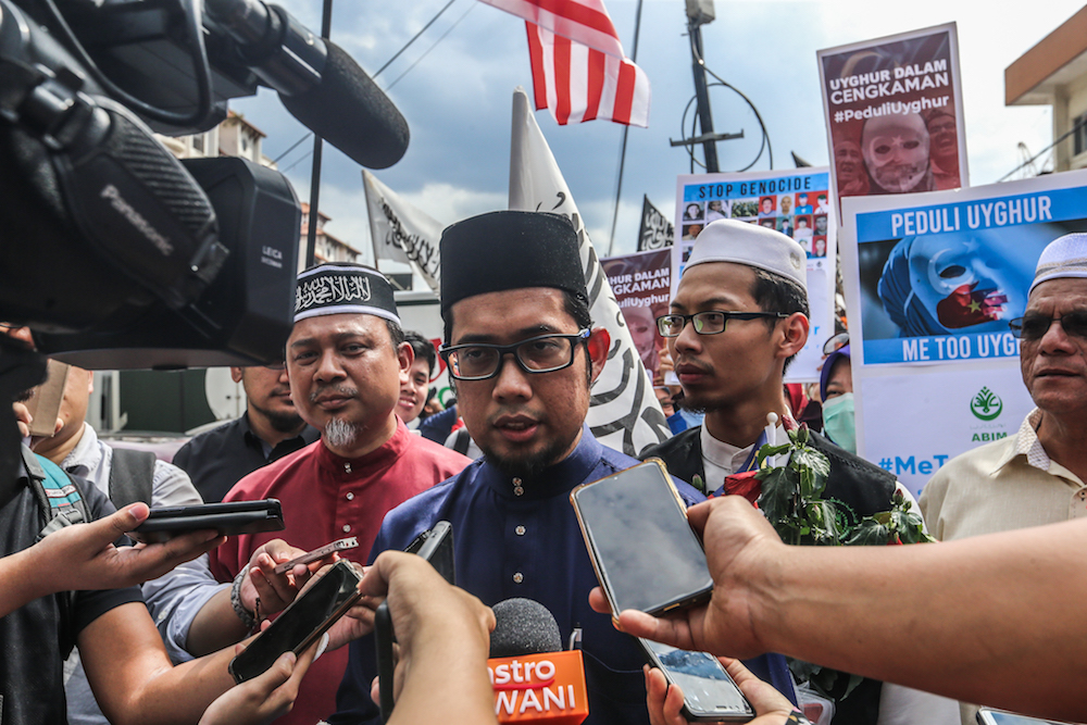 Abim president Muhammad Faisal Abdul Aziz speaks to reporters during a protest held in solidarity with China's Uighur Muslims in Kuala Lumpur December 27, 2019. — Picture by Firdaus Latif